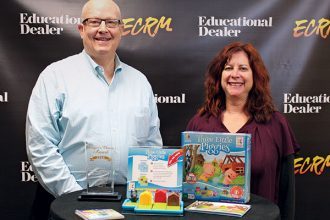 Corey Funkey and Iris Solomon from Smart Toys and Games with their top prize-winning game, Three Little Piggies. Call 800-542-6375 to order